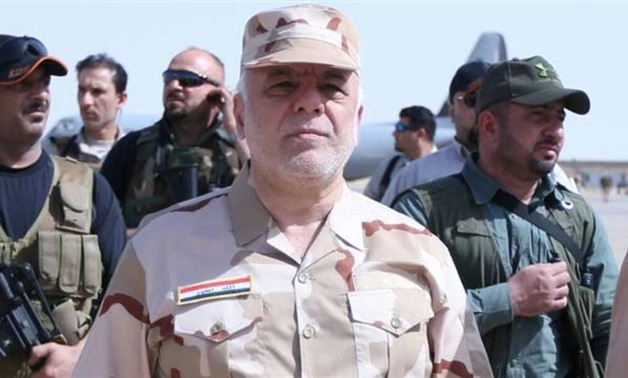 Iraqi Prime Minister Haider al-Abadi (C) walks during his visit to the flashpoint city of Mosul on May 29, 2017- Reuters