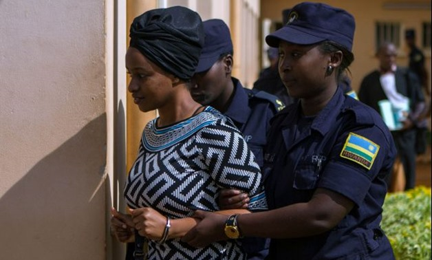 Sister of Kagame critic Diane Shiman Rwigara is escorted by police in Kigali - REUTERS