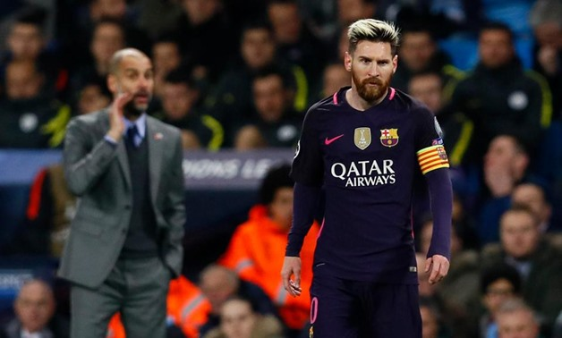 Pep Guardiola and Lionel Messi - Reuters