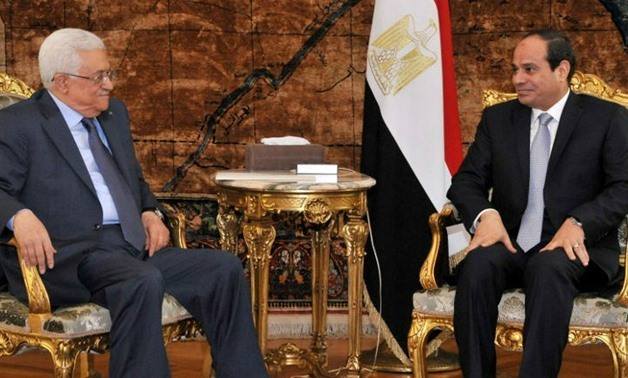 Egypt's Abdel Fatah al-Sisi talks with Palestinian president Mahmoud Abbas - File Photo