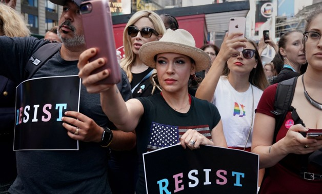 Actress Alyssa Milano attends a protest in Times Square, New York City, New York, U.S., July 26, 2017 – REUTERS