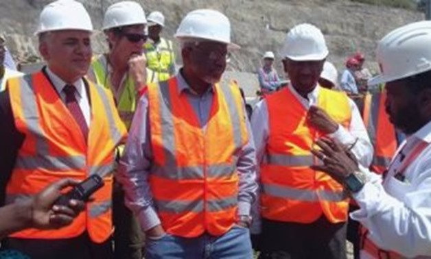 Water supply ministers of Egypt, Sudan, and Ethiopia at the construction area of the Grand Ethiopian Renaissance Dam – Press Photo by Egyptian Ministry of Irrigation and Water Supply