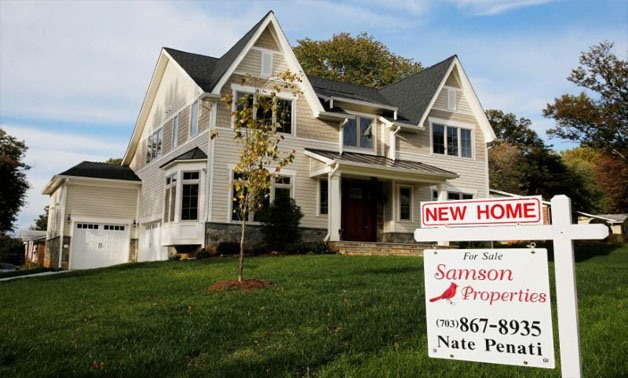 A real estate sign advertising a new home for sale is pictured in Vienna, Virginia, U.S. October 20, 2014 -  REUTERS/Larry Downing/File Photo