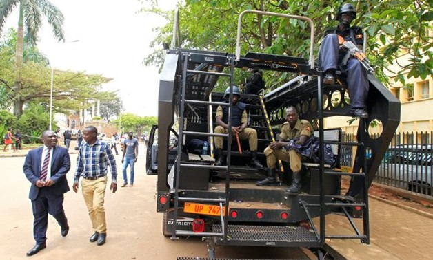 Ugandan anti terrorist police deployed at the entrance of the parliament ahead of proposed age limit amendment bill debate by lawmakers -- REUTERS