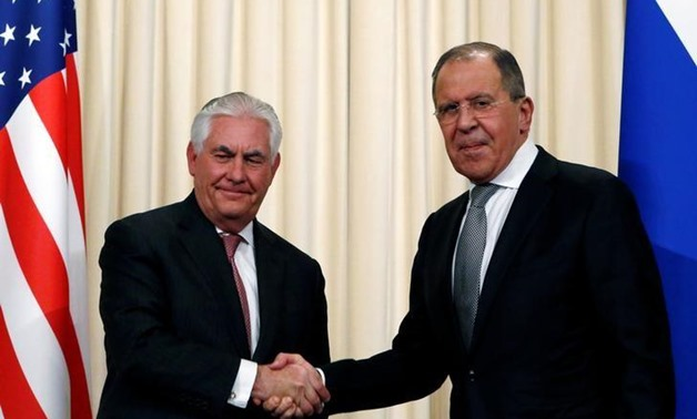 Russian Foreign Minister Sergei Lavrov shakes hands with U.S. Secretary of State Rex Tillerson during a news conference following their talks in Moscow -- REUTERS