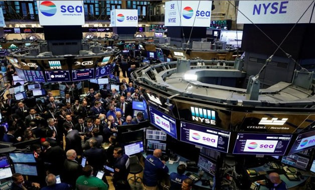 Traders gather for the IPO of Singapore-based Sea Limited on the floor of the New York Stock Exchange (NYSE) in New York, U.S., October 20, 2017. REUTERS/Brendan McDermid