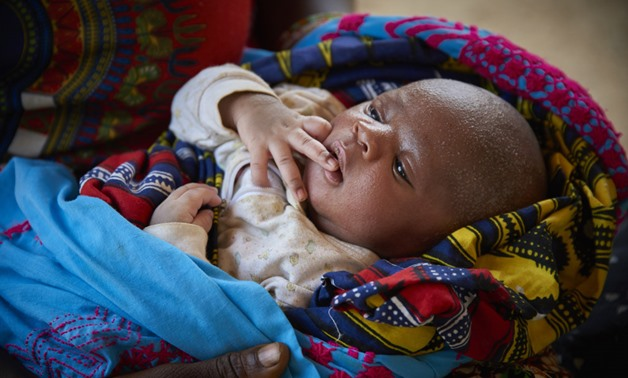 A Nine Day Old Baby Boy From Sierra Leone - Photo Credit UNICEF - Phelps
