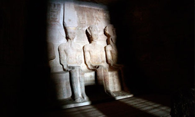 Dawn light shines on the statues of Pharaoh Ramses II (R) and Amun, the god of light (L), in the inner sanctum of the Abu Simbel temple in Aswan, Egypt, Feb. 22, 2014. Reuters/Mohamed Abdel Ghany