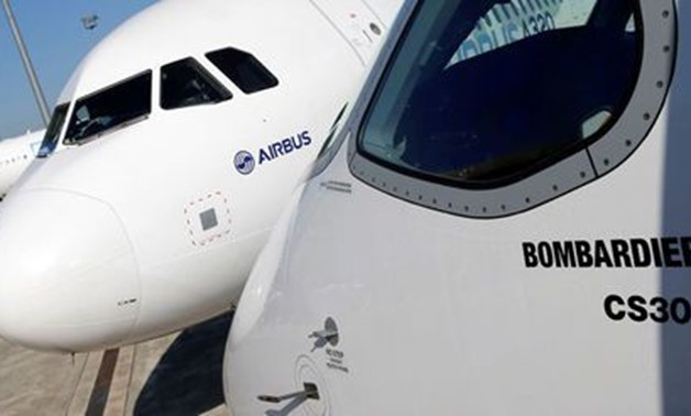 An Airbus A320neo aircraft and a Bombardier CSeries aircraft are pictured during a news conference to announce a partnership between Airbus and Bombardier on the C Series aircraft programme, in Colomiers near Toulouse, France, October 17, 2017. Picture ta