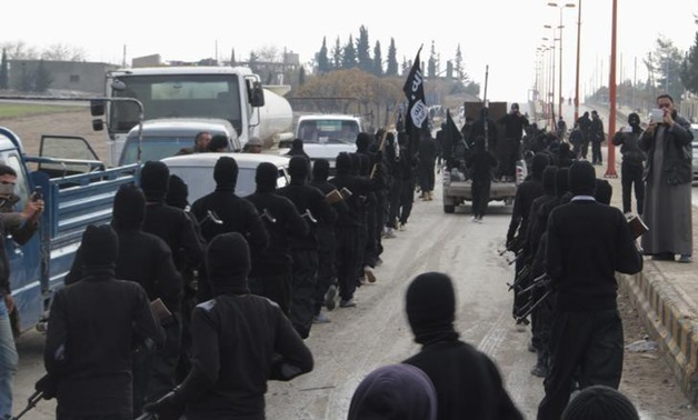 FILE- Fighters of al-Qaeda linked Islamic State of Iraq and the Levant parade at the Syrian town of Tel Abyad, near the border with Turkey January 2, 2014.- Reuters