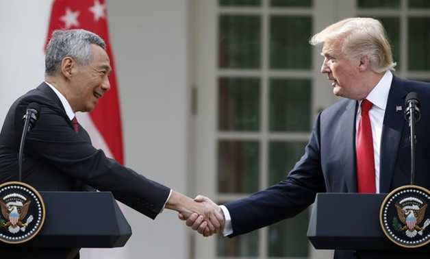 U.S. President Trump and Singapore Prime Minister Lee give joint statements at the White House in Washington -- REUTERS