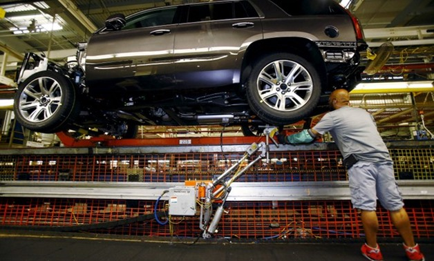 FILE- Mike Guillen works on the assembly line at the General Motors Assembly Plant in Arlington - REUTERS