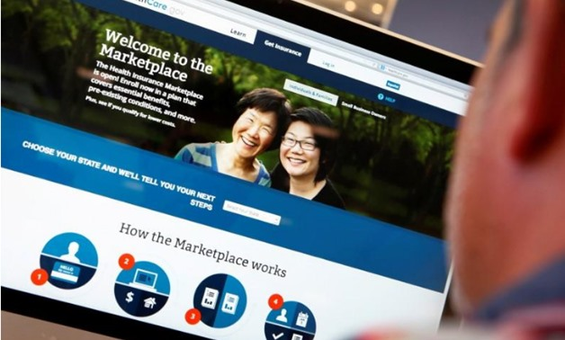 A man looks over the Affordable Care Act (commonly known as Obamacare) signup page on the HealthCare.gov website in New York in this October 2, 2013 photo illustration - REUTERS/Mike Segar/File Photo