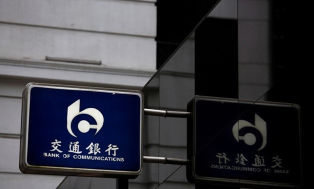 A logo of China's Bank of Communications is displayed outside its branch at the financial Central district in Hong Kong - REUTERS