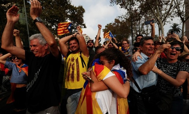 People celebrate after the Catalan regional parliament declares the independence from Spain in Barcelona - REUTERS