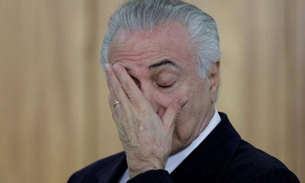 Brazilian President Michel Temer reacts during a credentials presentation ceremony for several new top diplomats at Planalto Palace in Brasilia - Reuters