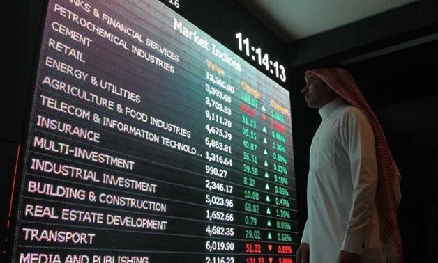 An investor monitors a screen displaying stock information at the Saudi Stock Exchange (Tadawul) in Riyadh, Saudi Arabia January 18, 2016.