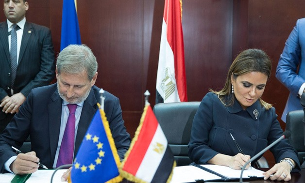 Commissioner for Neighborhood Policy and Enlargement Negotiations, European Commission, Johannes Hahn and Egyptian Minister of Investment and International Cooperation, Sahar Nasr- Press Photo