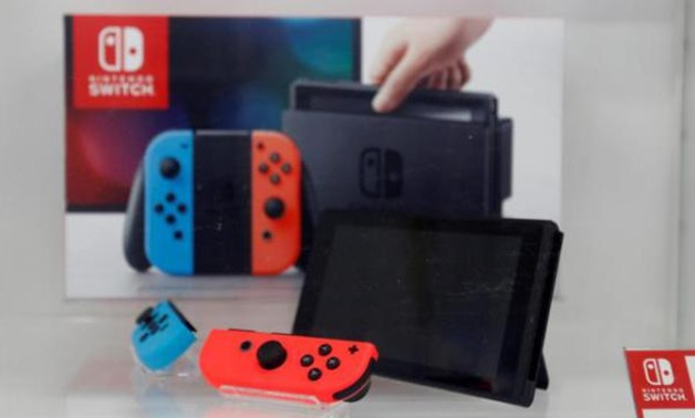 A Nintendo Switch game console is displayed at an electronics store in Tokyo, Japan. Reuters