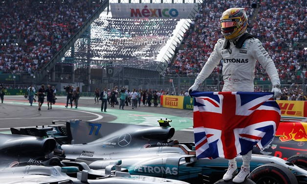 Mercedes' Lewis Hamilton celebrates after winning the World Championship –  Press image courtesy Reuters