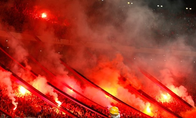 General view of fans with flares - REUTERS
