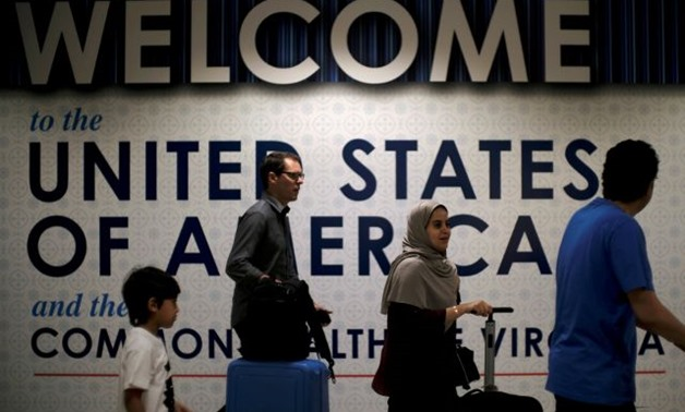 nternational passengers arrive at Washington Dulles International Airport in Dulles - REUTERS