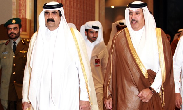 Former Emir of Qatar Sheikh Hamad bin Khalifa Al-Thani (L) and former Qatari Prime Minister and Foreign Minister Sheik Hamad bin Jassem Al-Thani (R) at the opening of the Doha Forum (AFP)