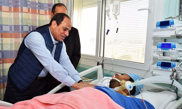 President Abdel Fatah al-Sisi visits recently freed Police Captain Mohamed al-Hayes in the hospital, after the latter was being held in terrorists' captivity.
