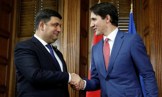Canada's PM Trudeau shakes hands with his Ukrainian counterpart Groysman in Ottawa - REUTERS