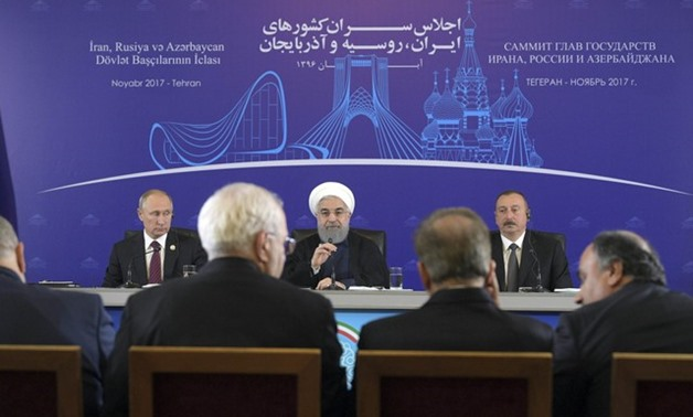 Russia's President Putin, Iran's President Rouhani and Azerbaijan's President Aliyev attend a news conference in Tehran - REUTERS
