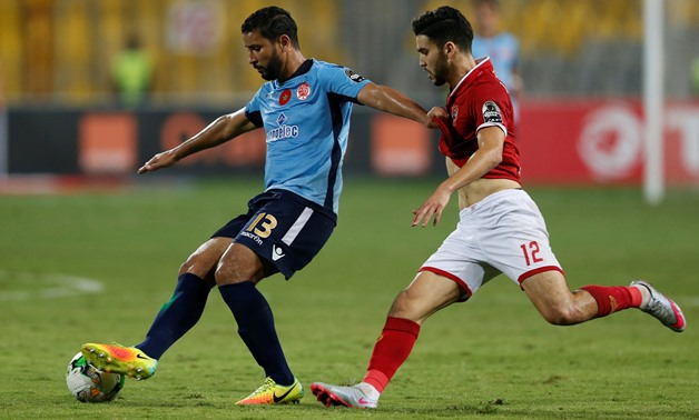 Wydad's Youssef Rabeh in action with Al Ahly's Walid Azarou - REUTERS