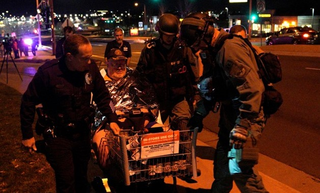 Patrick Carnes is evacuated in a Walmart cart by SWAT medics from the scene of a shooting at a Walmart where Carnes was shopping in Thornton - REUTERS