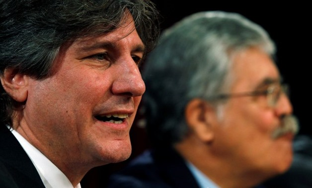 Former Argentine Vice President Boudou speaks next to Infrastructure Minister De Vido during a news conference in Buenos Aires - REUTERS