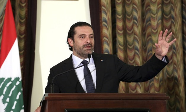 Lebanon's Prime Minister Saad al-Hariri gestures as he talks at the governmental palace in Beirut - REUTERS