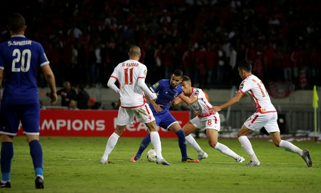Al Ahly's Mo'men Zakaria in action with Wydad's Ismail El Haddad REUTERS/Youssef Boudlal