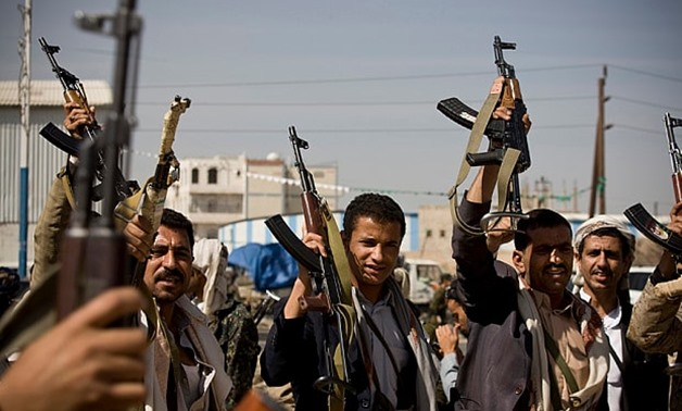 Houthi Shiite Yemeni hold their weapons during clashes near the presidential palace in Sanaa, Yemen - AFP