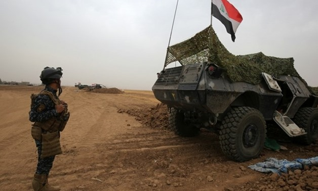 Iraqi forces gather at their camp on the front line in the northwestern town of Fishkhabur, near the borders with Syria and Turkey, on October 28, 2017. AFP / AHMAD AL-RUBAYE