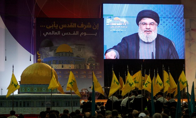 Lebanon's Hezbollah leader Sayyed Hassan Nasrallah addresses his supporters via a screen during a rally marking Al-Quds day in Beirut's southern suburbs, Lebanon June 23, 2017. REUTERS/Aziz Taher/File Photo