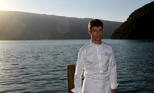 French chef Jean Sulpice poses in front of his restaurant 'L'Auberge du Pere Bise' in Talloires in the French Alps. Sulpice was named chef of the year in the 2018 Gault Millau Guide - AFP
