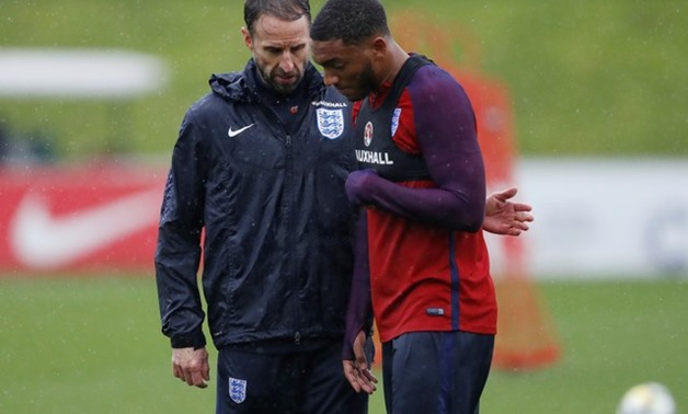 Soccer Football - England Training - St. George's Park, Burton upon Trent, Britain - November 7, 2017 England manager Gareth Southgate and Joe Gomez during training Action Images via Reuters/Carl Recine