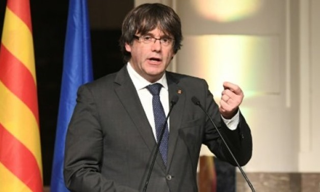 Catalonia's sacked leader Carles Puigdemont delivers a speech during a meeting with Catalan mayors in Brussels