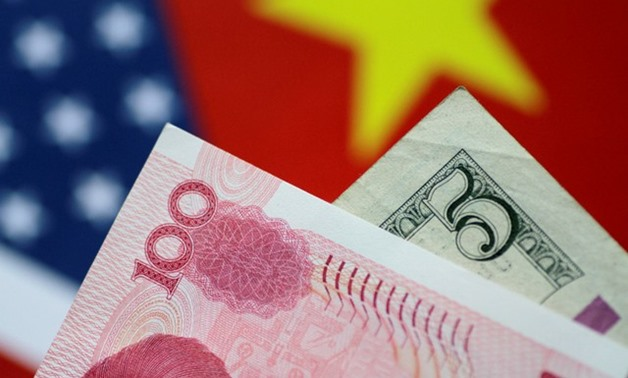 U.S. Dollar and China Yuan notes are seen in this picture illustration June 2, 2017 - REUTERS/Thomas White/Illustration/File Photo