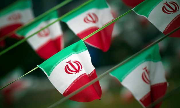 Iran's national flags are seen on a square in Tehran February 10, 2012, a day before the anniversary of the Islamic Revolution. REUTERS/Morteza Nikoubazl/File Photo