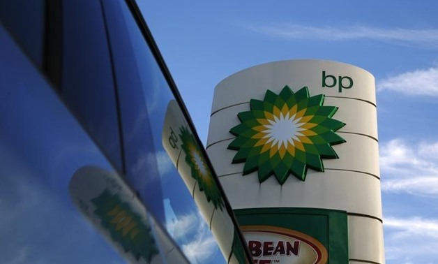 A BP logo is reflected in a car window at a petrol station in London- Luke MacGregor- Reuters