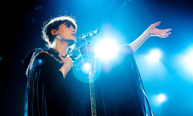 "A look in depth at Florence + the machine's depiction of unrequited love through their song ""Cosmic Love""- Florence Welch at a concert in May 2012 - Anaïs Chaine - Wikimedia commons"
