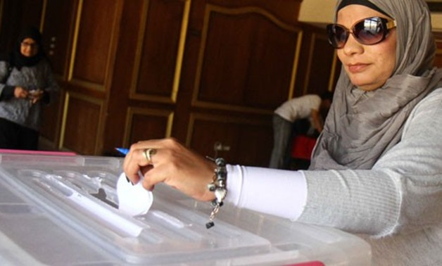Egyptian Woman Casts Her Ballot In Election Box - File photo
