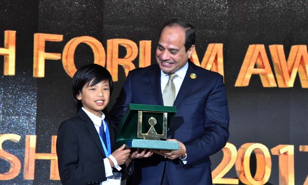 President Sisi honors Yuma Soerianto, youngest programmer who designed four applications, one dedicated to helping families unable to afford the food to find a place to eat- press photo