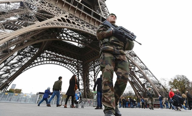 French military patrol near the Eiffel Tower the day after a series of deadly attacks in Paris- Reuters