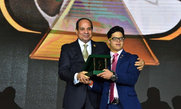 FILE- President Sisi honors swimmer Mohamed Al-Husseini, first Egyptian swimmer with Down Syndrome, who tried to cross the English channel - Press photo