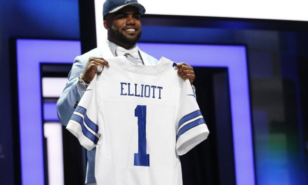 Ezekiel Elliott (Ohio State) after being selected by the Dallas Cowboys as the number four overall pick in the first round of the 2016 NFL Draft at Auditorium Theatre. Mandatory Credit: Kamil Krzaczynski-USA TODAY Sports / Reuters